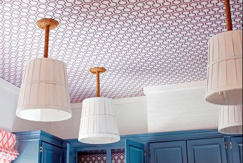 A graphic wallpapered kitchen ceiling.