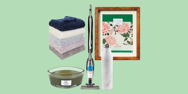 blankets, vacuum, candle, picture frame, and water bottle grouped together with green background