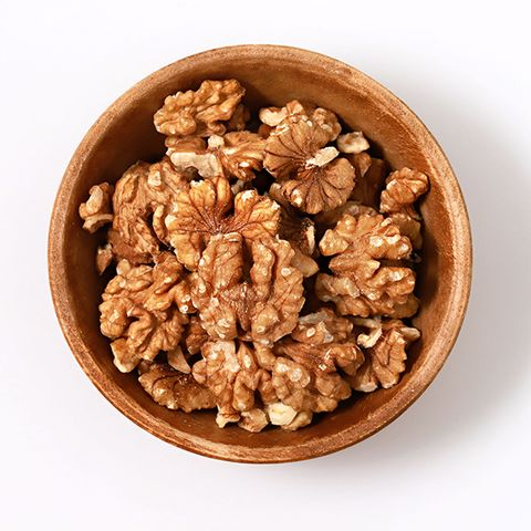 Directly Above Shot Of Walnuts In Bowl Against White Background