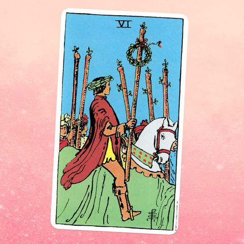 the tarot card the six of wands, showing a person on a horse holding a wooden staff with a wreath of leaves tied to it people holding five more staffs stand on the ground nearby