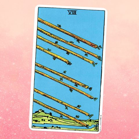 the tarot card the eight of wands, showing eight wooden staffs pointed down across a sky, a hill and river in the background