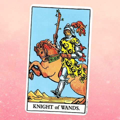 The Knight of Wands tarot card, showing a knight in armor on horseback over a desert landscape, holding a wooden staff