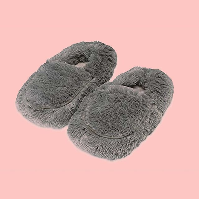 gray slippers with pink background
