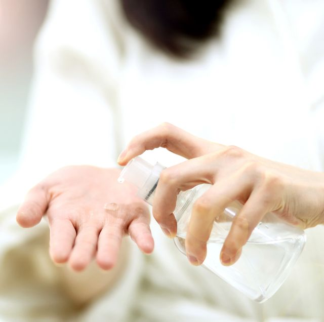washing hands, woman taking on hands liquid soap from dispenser