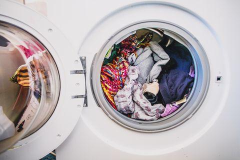 laundry daywashing machine full of colorful clothes