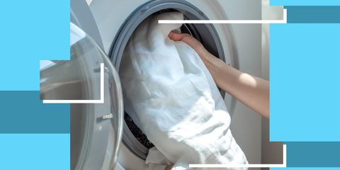 person loading sheets into a washing machine