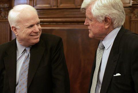 US Senator John McCain (L), R-AZ, smiles