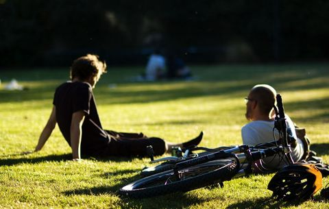 cyclists resting in a park