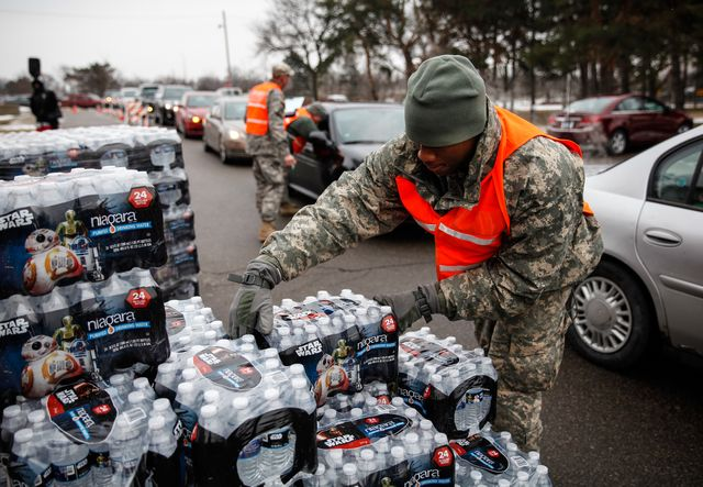 flint, mi   january 21  army national guard specialist david brown loads bottled water into waiting cars at a fire station on january 21, 2016 in flint, michigan residents can go daily to fire stations in the city to pick up more water  photo by sarah ricegetty images