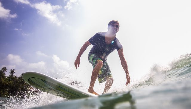 water level view of surfer riding waves