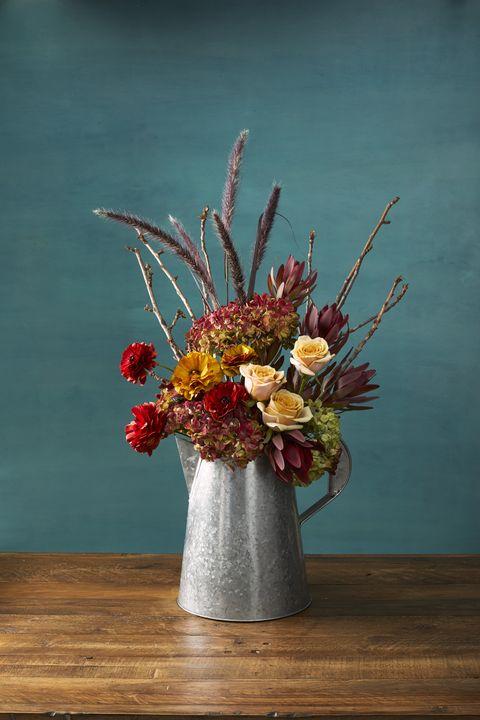 pretty pitcher autumn flower arrangement