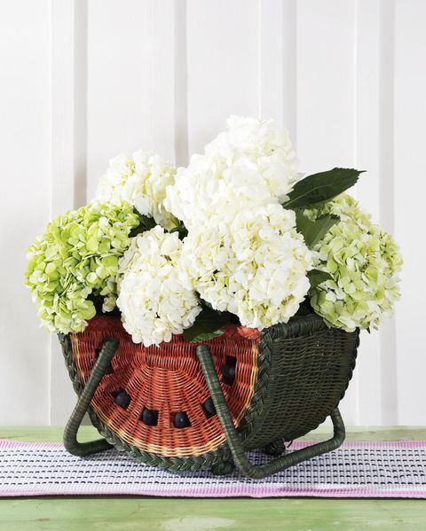 watermelon basket with hydrangea blooms