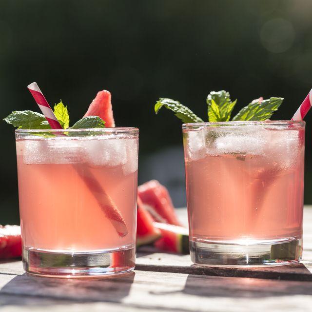 watermelon hugo, mojito in glasses with drinking straw