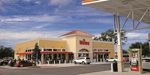 Building, Filling station, Sky, Rest area, Architecture, Gasoline, City, Outlet store, Mixed-use, Plaza,