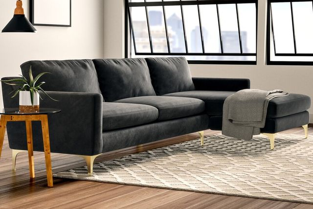 sofa, sidetable and ottoman in a room