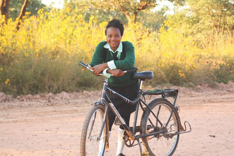 "a recipient with her donated ""buffalo bike"" from world bicycle relief"