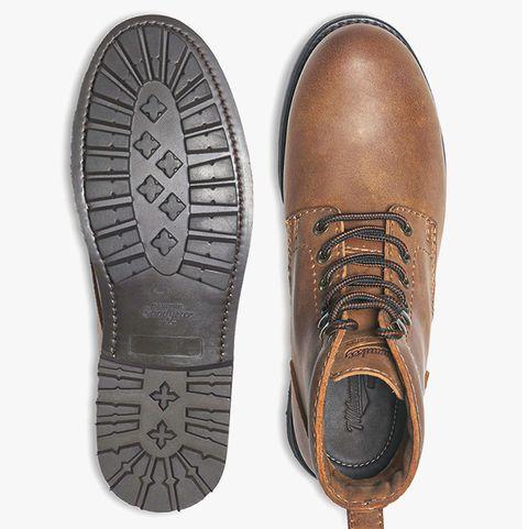 man wearing milwaukee pfister boot