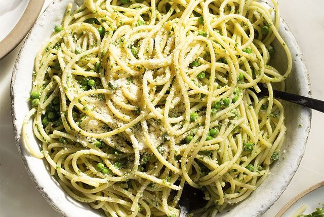 nettle pesto bucatini with spring peas and parmesan