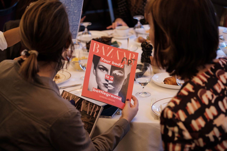 Guests admiring copies of Bazaar Art