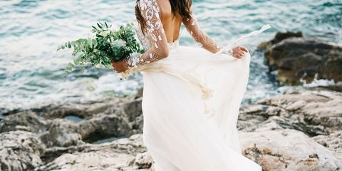 Clothing, Dress, Skin, Bridal clothing, Photograph, Petal, Elbow, Happy, People in nature, Wedding dress,