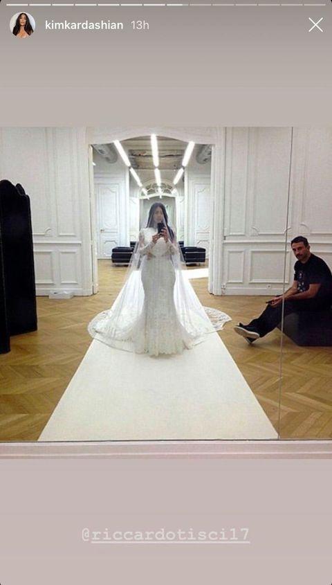 Kim Kardashian Posts Throwback Wedding Dress Photos from 9