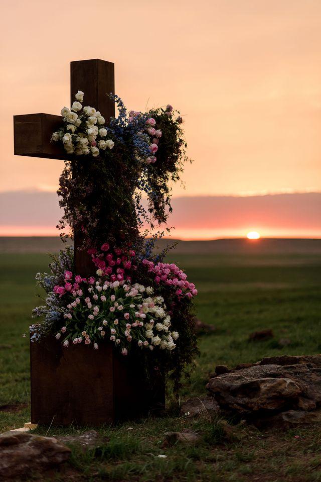 the cross at alex drummond and mauricio scott's wedding ceremony