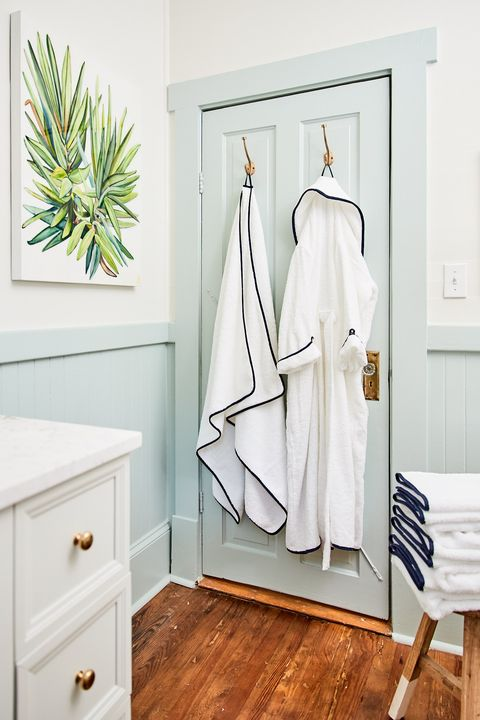 bathroom with weezie towels and robe