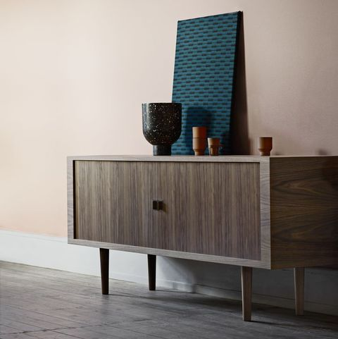 Walnut 'CH825' credenza sideboard by hans J Wegner standing against a peach coloured wall