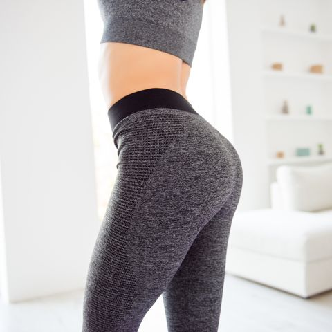 weightloss wellness eating nutrition vitality concept cropped close up view photo of sexual sporty sportive tempting beautiful attractive nice round ass wearing gray tight pants leggings