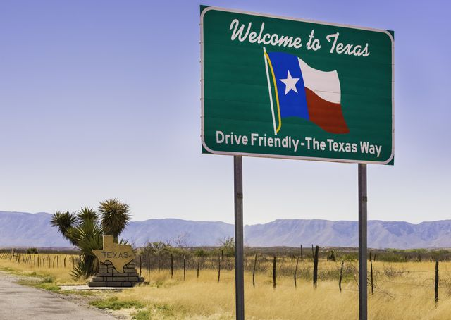 welcome to texas and drive friendly road sign