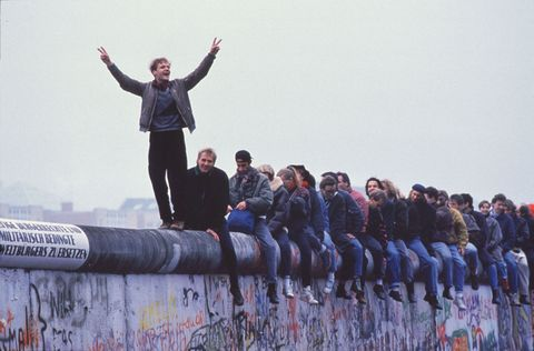 West Germans Celebrate The Unification Of Berlin Atop The Berlin Wall During The Collaps...