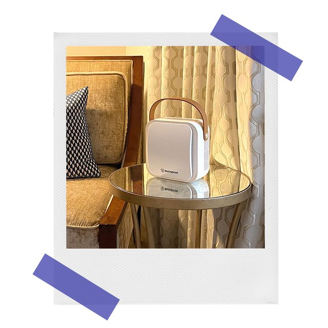 westinghouse air purifier on hotel room side table