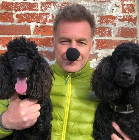 chris packham alongside two beautiful dogs wearing a nose for wetnose day