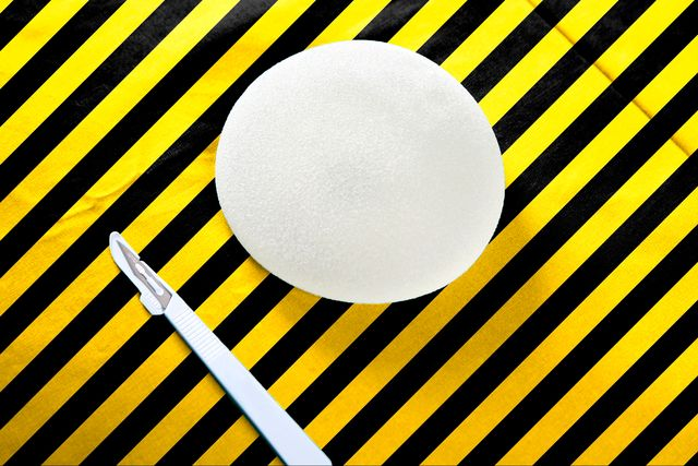 breast implant and scalpel with caution colors