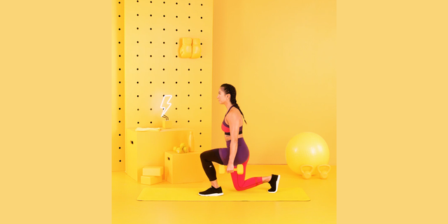 trainer tatiana lampa performing lunge with dumbbells