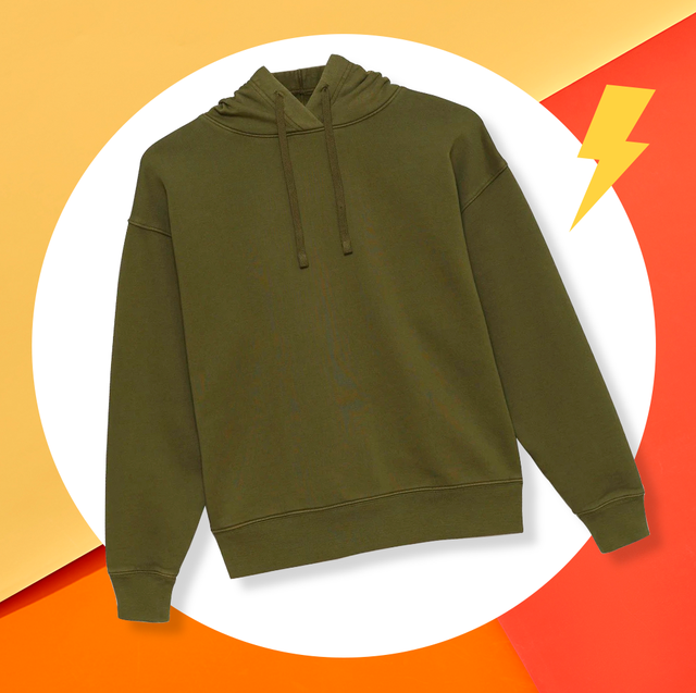 green hoodie on orange background