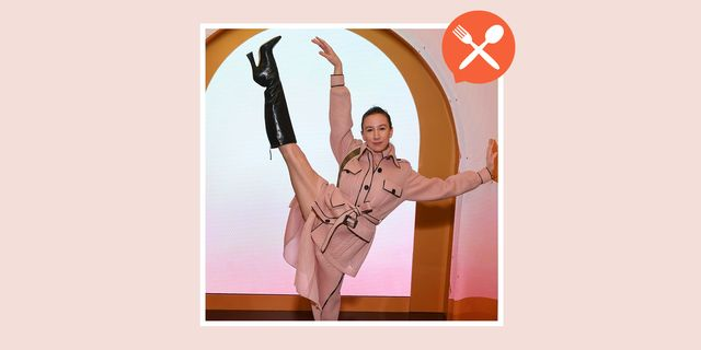 dancer isabella boylston performing pose in trench coat
