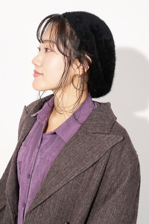 Hair, Clothing, Purple, Outerwear, Neck, Hairstyle, Beanie, Jacket, Headgear, Hat,