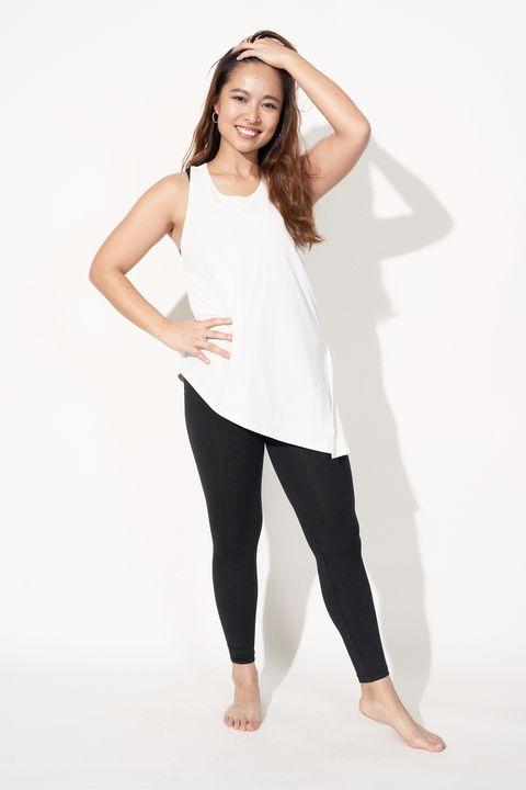 White, Clothing, Black, Shoulder, Leggings, Standing, Yellow, Arm, Joint, Sleeve,