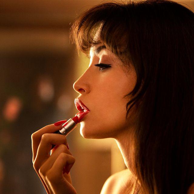 christian serratos doing makeup as selena quintinalla
