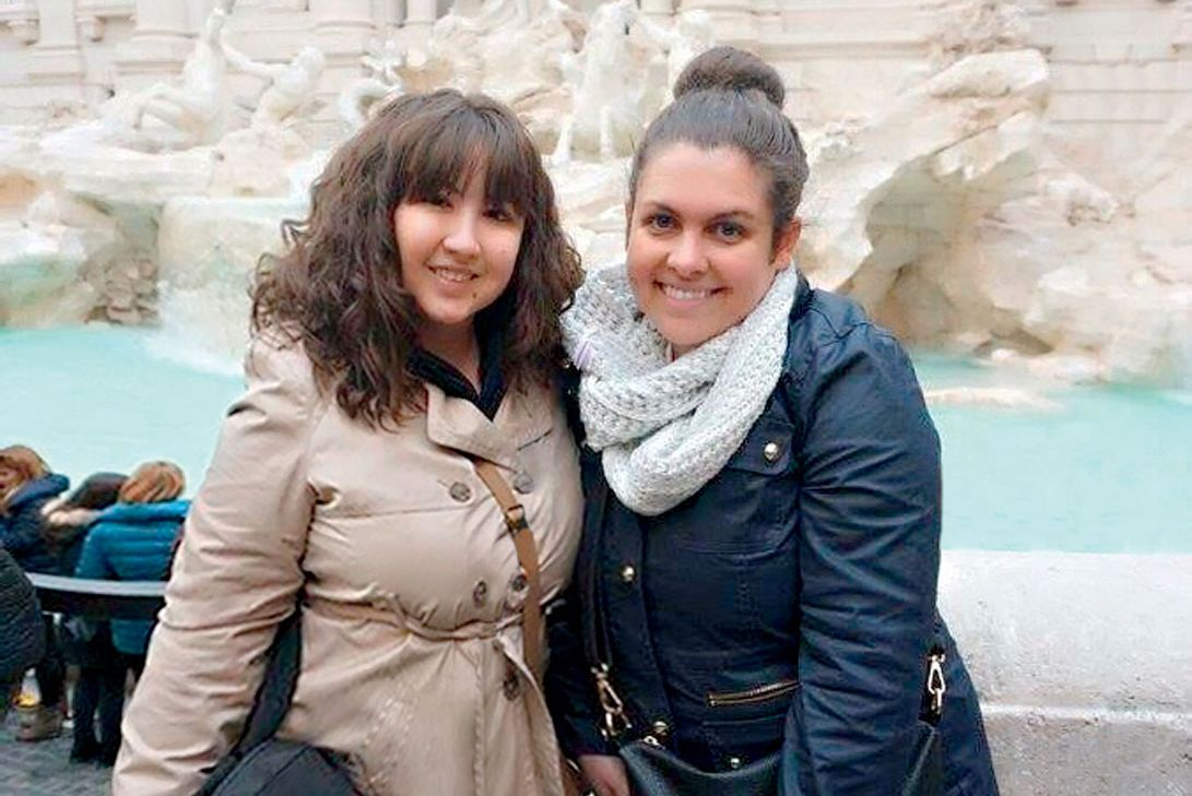 Karen Hopkins and Alexandra Booze friends in front of Trevi fountain in Rome
