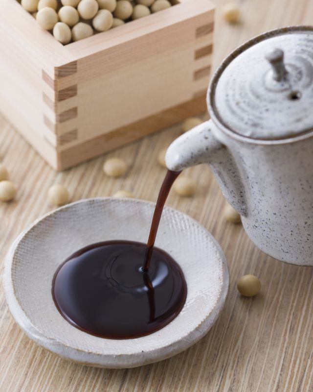 tamari sauce in dipping bowl with soybeans