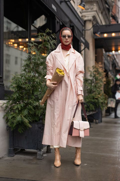 Clothing, White, Fashion, Fashion design, Fashion model, Outerwear, Trench coat, Street fashion, Temple, Event,
