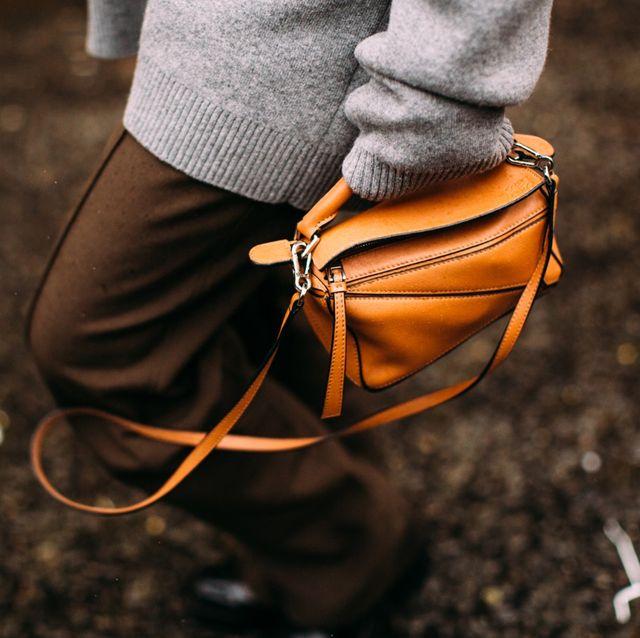 Orange, Footwear, Brown, Shoe, Hand, Photography, Jeans, Soil, Street fashion,