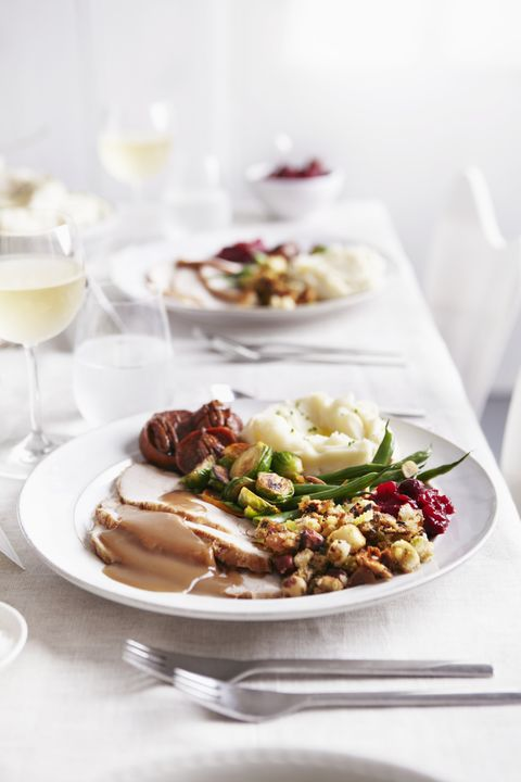 table set with turkey meal and white wine