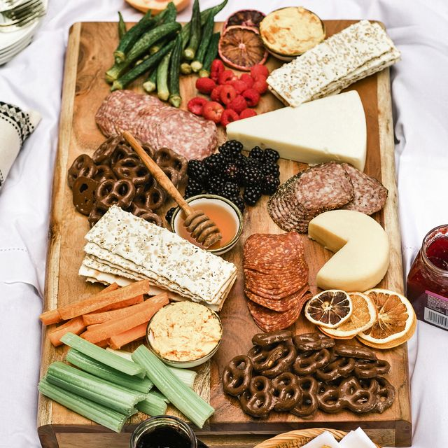 a charcuterie board with meats and cheeses