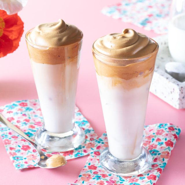 whipped coffee two tall glasses with milk and sugar