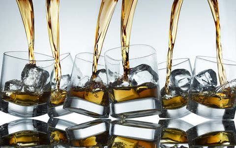 Hard liquor being poured into glasses