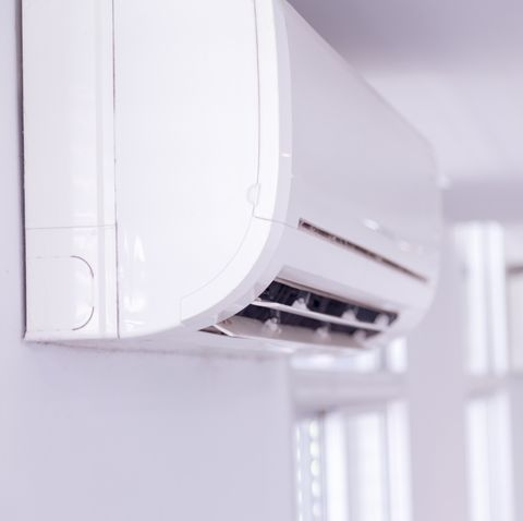 white air conditioner on wall