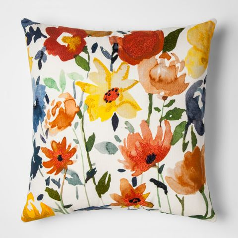 white and cream floral throw pillow